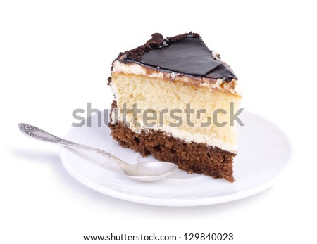 Tasty chocolate cake on a white plate over white background - stock photo
