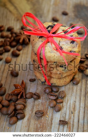Tasty chocolate cookies with red ribbon and coffee beans - stock photo