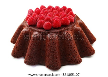 Tasty chocolate muffin with raspberries isolated on white - stock photo