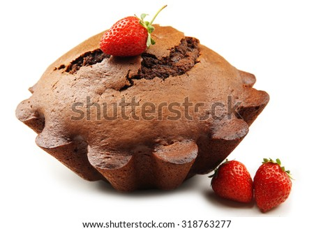 Tasty chocolate muffin with strawberries isolated on white - stock photo