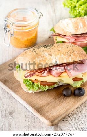 Tasty ciabatta sandwich with meat and cheese,selective focus  - stock photo
