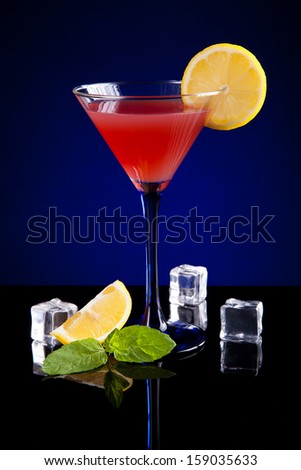 Tasty cocktail on dark background  - stock photo