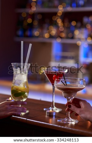 Tasty colorful alcoholic drinks on the bar - stock photo
