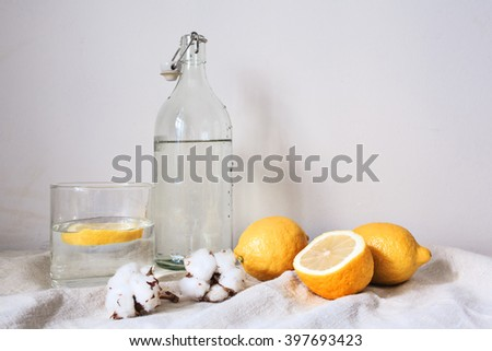 Tasty cool beverage with lemon on white cotton fabric - stock photo