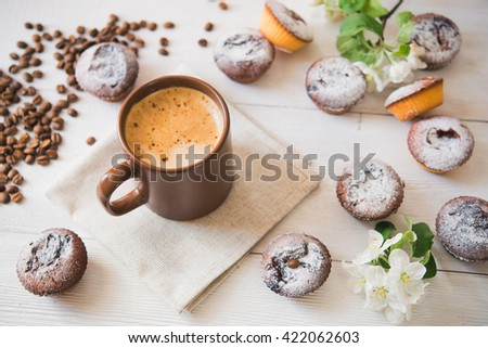 tasty cup of coffee and cakes on white board - stock photo