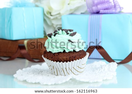 Tasty cupcake with gifts close up - stock photo