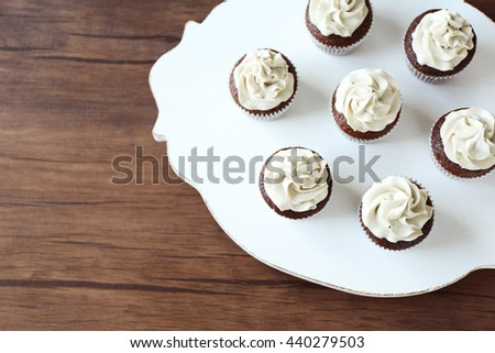 Tasty cupcakes on plate. Top view - stock photo