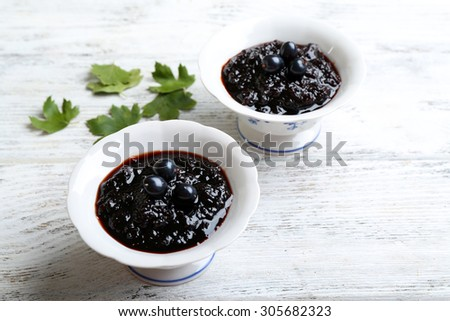 Tasty currant jam on table close up - stock photo