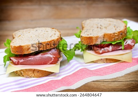 Tasty, delicious sandwiches with prosciutto - stock photo
