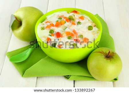 tasty dieting food and apples on wooden table - stock photo
