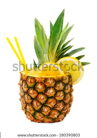Tasty drink in pineapple isolated on white background - stock photo