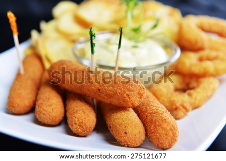 tasty fish sticks and potatoes deep fried - stock photo