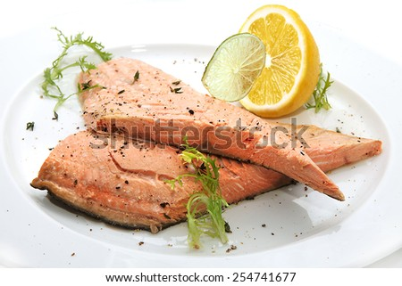 Tasty fish with lemon - stock photo