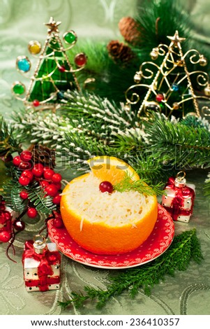 Tasty food - appetizer in orange on a holiday and Christmas decor - stock photo