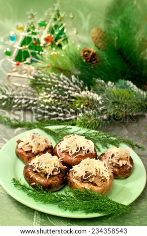 Tasty food - appetizer of mushroom; on a holiday and Christmas decor - stock photo