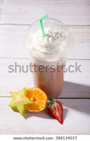 tasty, frappucino with whipped cream, on wooden background - stock photo