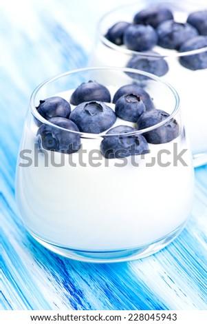 Tasty fresh blueberry yoghurt shake dessert on table - stock photo