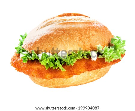 Tasty golden fried crumbed veal schnitzel or escalope bun topped with fresh green frilly lettuce and mayonnaise on white with clipping path - stock photo