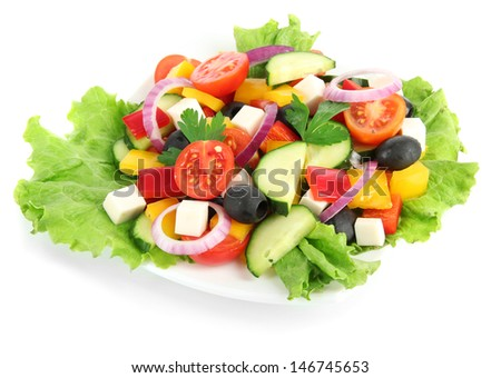 Tasty Greek salad isolated on white - stock photo