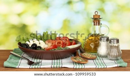 tasty greek salad on bright green background - stock photo