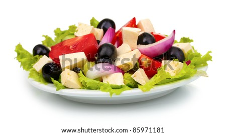 Tasty greek salad on plate isolated on white - stock photo