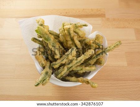 Tasty Green Beans Tempura, also called peixinhos da horta, in a bowl - stock photo
