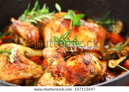 Tasty grilled chicken with vegetable and herbs - stock photo