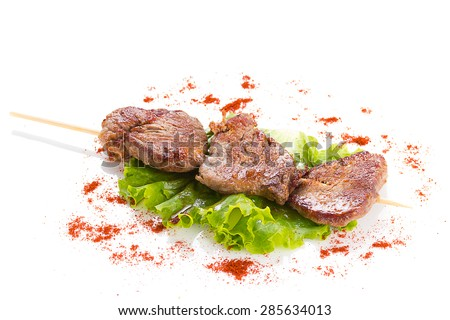 tasty grilled meat and vegetables on skewers, isolated on white on white background - stock photo