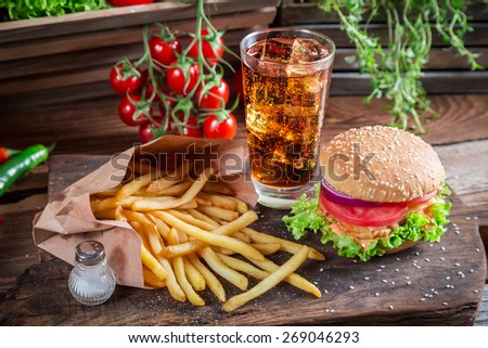 Tasty hamburger with cold drink and fries - stock photo