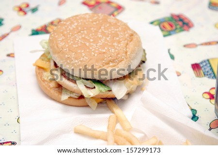 Tasty hamburger with fries, unhealthy food, health concept - stock photo