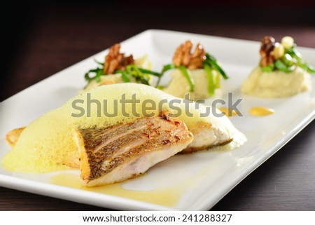 Tasty healthy fish fillet with potato and vegetables  - stock photo