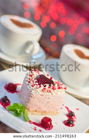 tasty heart shaped valentine cake - stock photo
