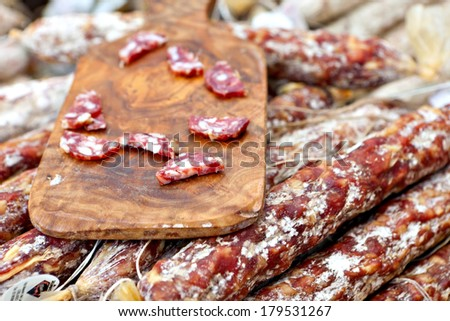 Tasty home-made Italian salami sausage at the farmers market  - stock photo