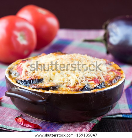 Tasty Italian dish, appetizer with eggplant, cheese and tomato sauce in cup - stock photo