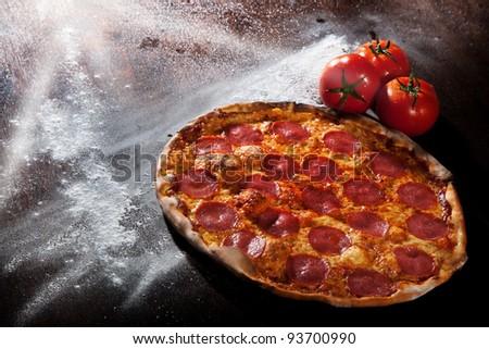 Tasty Italian pepperoni pizza - stock photo