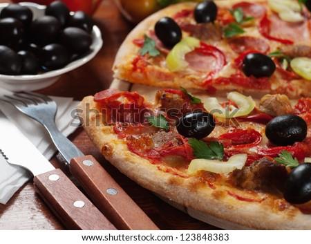 Tasty Italian pizza on the table - stock photo