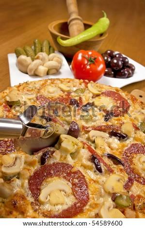 tasty italian pizza (shallow DOF) - stock photo