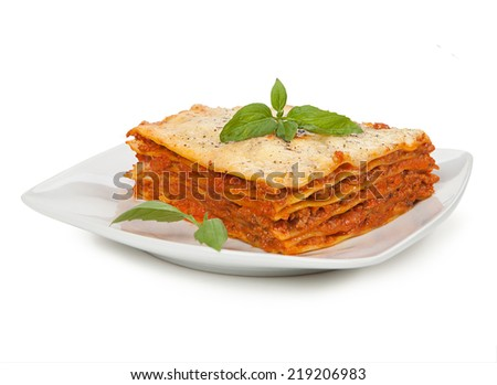 Tasty lasagna isolated on plate - stock photo