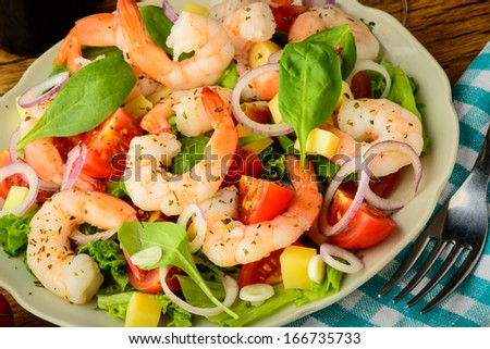 tasty meal with fresh and healthy prawn salad and vegetables - stock photo