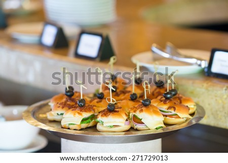 Tasty mini hamburgers sliders on plate - stock photo