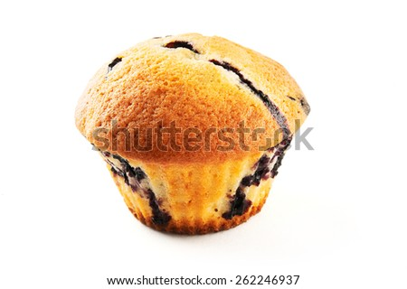 Tasty muffins with blueberry on white background - stock photo