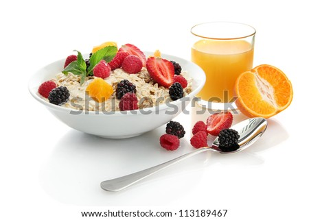 tasty oatmeal with berries and glass of juice, isolated on white - stock photo