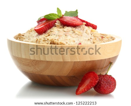 tasty oatmeal with strawberries, isolated on white - stock photo