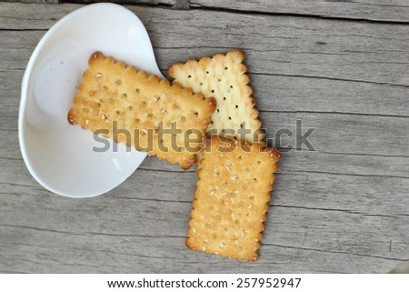 Tasty of crackers on wood table - stock photo