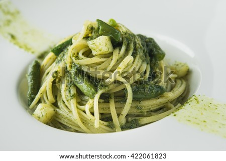 tasty pasta with asparaguson white plate - stock photo