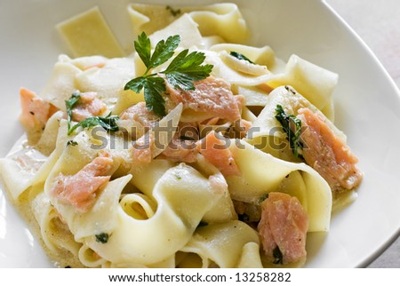 tasty pasta with cream, salmon cheese and parsley close up - stock photo