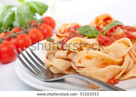 tasty pasta with tomato sauce - stock photo