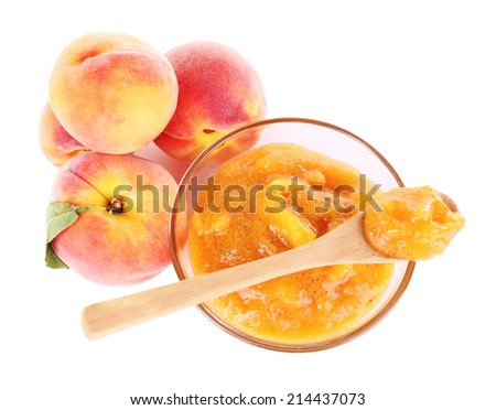 tasty peach jam with fresh peaches, isolated on white - stock photo