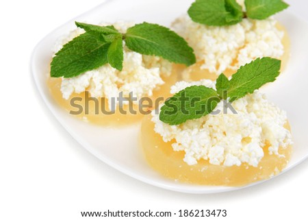 Tasty pineapple with cottage cheese, isolated on white - stock photo