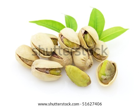 Tasty pistachio with leaves - stock photo
